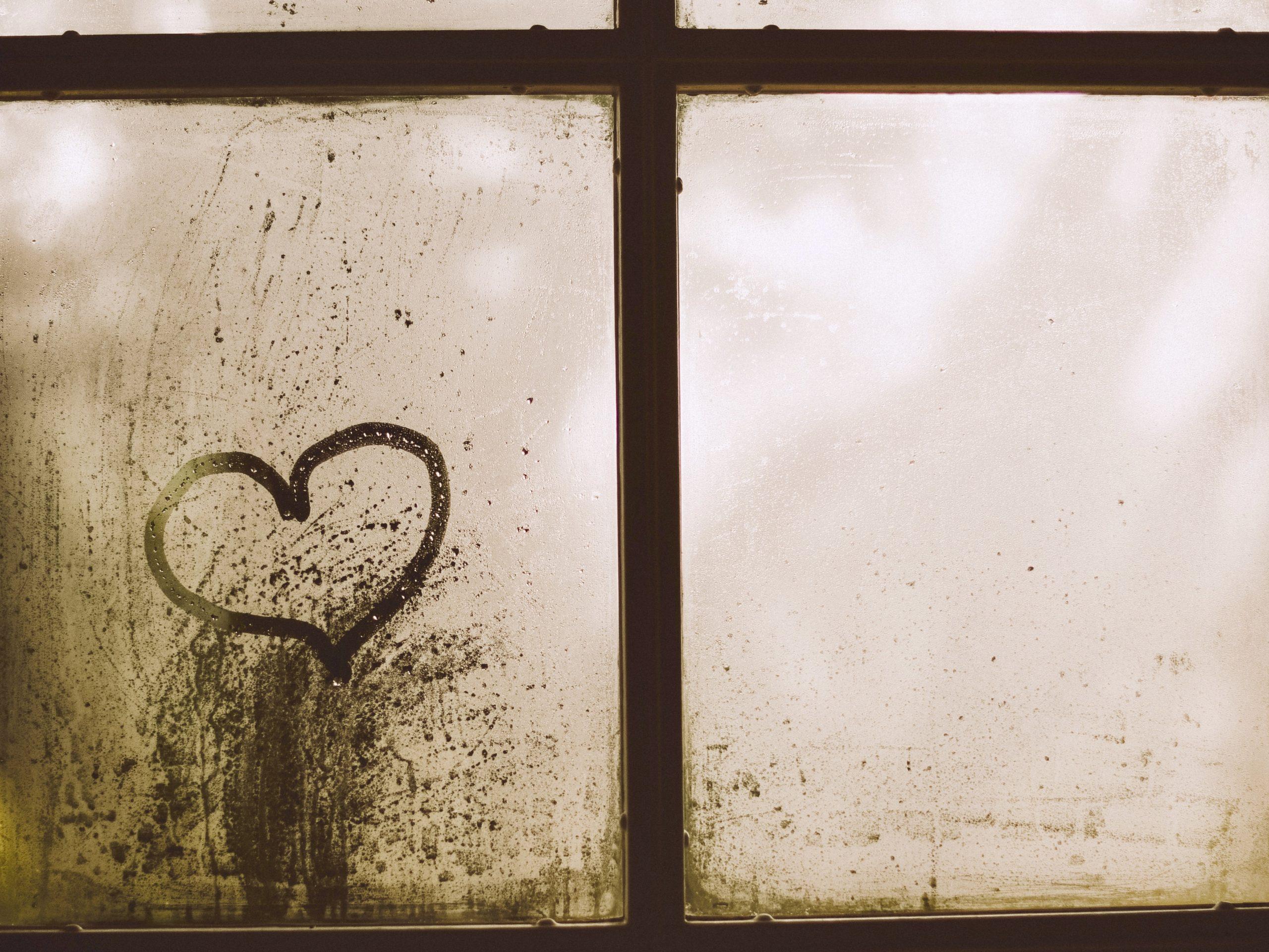 Heart drawn on a foggy window