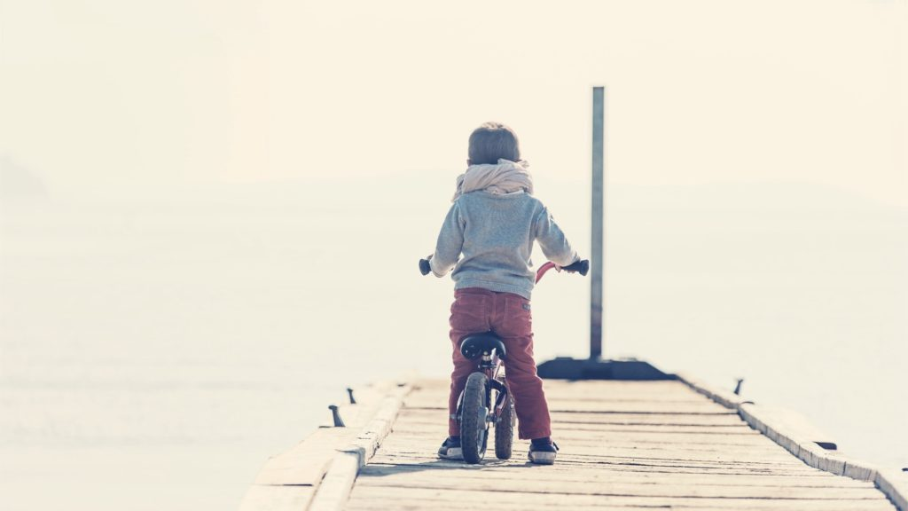 Girl riding a bicycle on the pier
