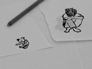 Drawn sad child head on knees