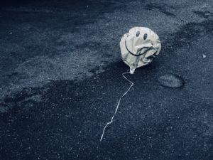Deflated smiley balloon