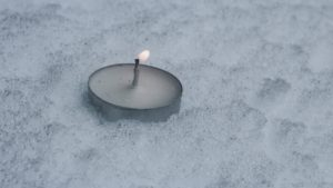 A candle on snow