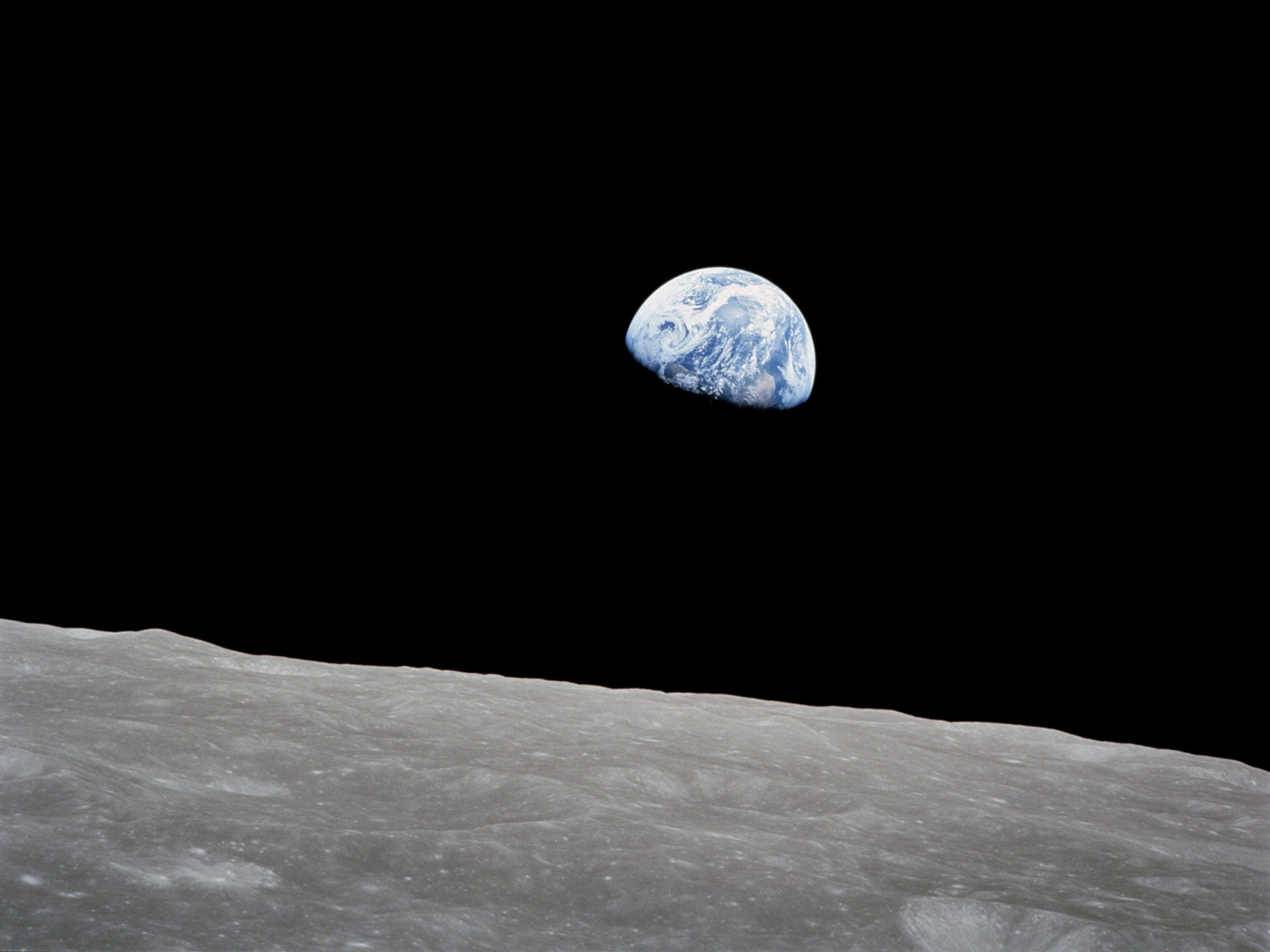 Apollo 8 Mission image, Earth over the horizon of the moon