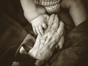 Hand to hand, grandma and grandson