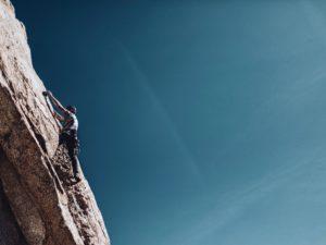 A man climbing a cliff