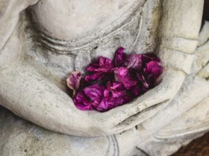 Meditative statue with flowers
