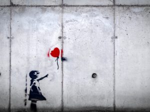 Heartbreak balloon and girl wall artwork