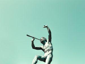 Man using a musical instrument statue, Paris