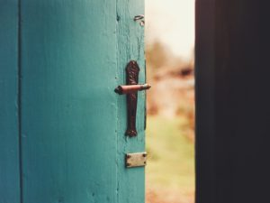 Outside seen through the turquoise wooden door
