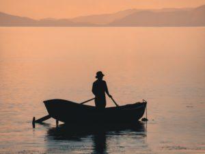 A man on a boat/ Isla del sol, Bolivia