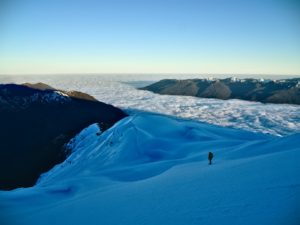 A man walking in a snow covered mountain/ Hornopirén, hualaihué, Chile
