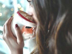 Girl drinking on Santa Claus mug; It's officially Christmas when this mug gets pulled out.