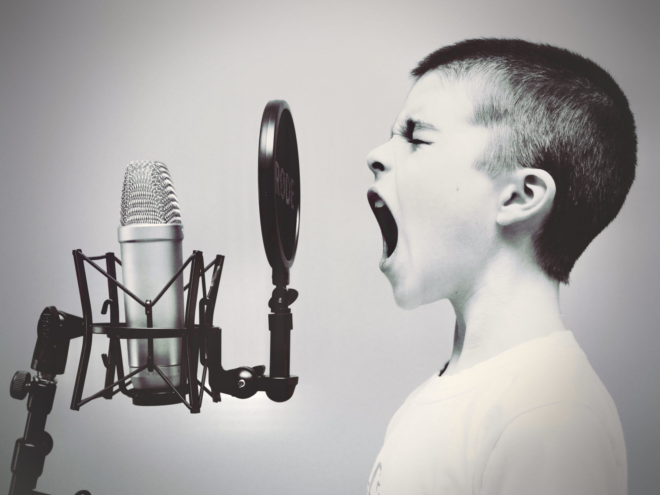 Boy singing on a microphone; Parry sound, Canada