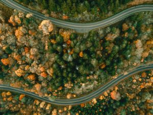 Passing on a road in fall season. Aerial view.