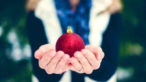 Holding a Christmas ball